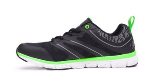 Lime green and black sport unisex shoes isolated on white background. Lime green and black sport unisex shoes isolated on white background Royalty Free Stock Image
