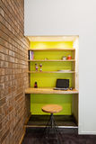 Lime green feature wall study nook in living room Stock Image