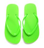Lime green flipflops on a white background Stock Photography