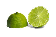 Lime. Green lime halves on white background Royalty Free Stock Photography