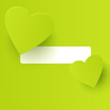 Lime green heart-shapes. Two lime green heart-shapes on a lime green background with a white copy space Royalty Free Stock Images