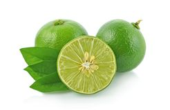 Lime with green leaves isolated on white background stock photo