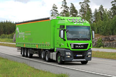 Lime Green MAN TGX Cargo Truck on Motorway Stock Photo