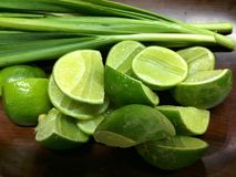 Lime and green onion Royalty Free Stock Photography