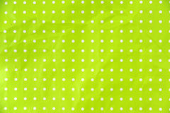 Lime green paper with white dots Royalty Free Stock Photo