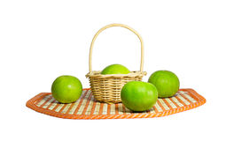 Lime green put in the basket on white background. Stock Image