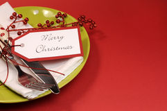 Lime green and red Merry Christmas table place setting, with copy space for your text here. Stock Photo