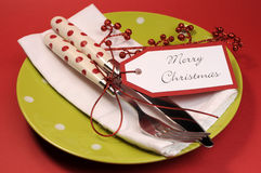 Lime green and red Merry Christmas table place setting. Royalty Free Stock Images