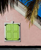 Lime green shutters accent Caribbean pink building in Nassau, Bahamas Stock Image
