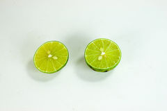 Lime. Green Thai lime in white background Royalty Free Stock Photos