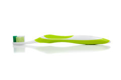 Lime green toothbrush on white Royalty Free Stock Photography