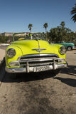 Lime green vintage Chevrolet convertible taxi Havana Royalty Free Stock Photos