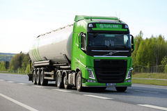 Lime Green Volvo Semi Tank Truck on Freeway at Spring Royalty Free Stock Image