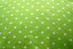 Lime green with white dots as background. With colored light stock photography