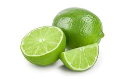 Lime with half isolated on white background.  stock photos