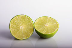 Lime halfed. Fresh cut lime halves on a plane background stock photography