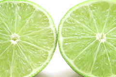 Lime halfs upclose. Shot of lime halfs upclose Royalty Free Stock Photo