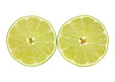 Lime halves cutout. Bright green lime halves cutout on white background Stock Images