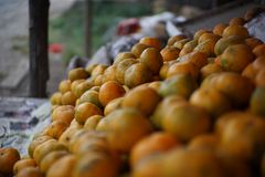 Lime orange at stall, Medan Indonesia. A lime is a hybrid citrus fruit, which is typically round, lime green, 3–6 centimetres (1.2–2.4 in&#x29 royalty free stock images