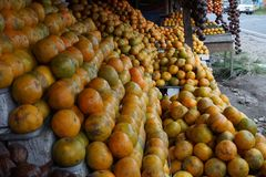 Lime orange at stall, Medan Indonesia. A lime is a hybrid citrus fruit, which is typically round, lime green, 3–6 centimetres (1.2–2.4 in) in stock photography