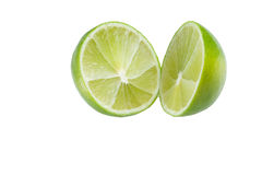 Lime isolated. Lime cut in half isolated Royalty Free Stock Photos