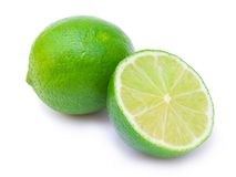Lime and its half. Green lime and its half isolated on white Stock Images
