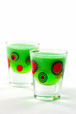 Lime jello Shooters. With a white background Stock Images