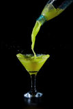 Lime juice is being poured into a glass beaker Royalty Free Stock Image