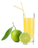 Lime juice glass with ripe limes Royalty Free Stock Photos