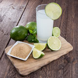 Lime Juice on wood Royalty Free Stock Photography