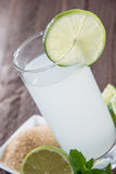 Lime Juice on wood Royalty Free Stock Photo