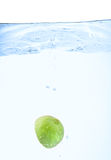 Lime just after falling under the wate Royalty Free Stock Photo