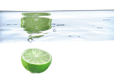 Lime just after falling under the water Royalty Free Stock Photography