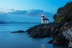 Lime Kiln Lighthouse. This lighthouse is located on San Juan Island in the Puget Sound area of western Washington, USA. Shot at sunset the long exposure gives Stock Images