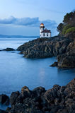 Lime Kiln Lighthouse. This lighthouse is located on San Juan Island in the Puget Sound area of western Washington, USA. Shot at sunset the long exposure gives Royalty Free Stock Image