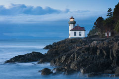Lime Kiln Lighthouse. This lighthouse is located on San Juan Island in the Puget Sound area of western Washington, USA. Shot at sunset the long exposure gives Royalty Free Stock Photo