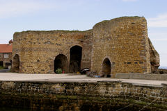 Lime Kilns Beadnell Northumberland England. A lime kiln is a kiln used to produce quicklime by the calcination of limestone (calcium carbonate Royalty Free Stock Images