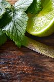 Lime and knife. On wooden board. Royalty Free Stock Photography