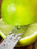 Lime and knife. On wooden board. Stock Image