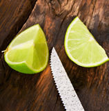 Lime and knife. On wooden board. Stock Photography