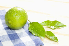 Lime with leaf on napkin,close up Royalty Free Stock Images