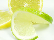 Lime and lemon. Close-up of a lime slice in front of a lemon half Royalty Free Stock Photography