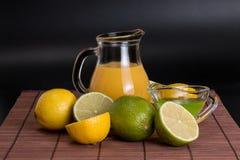 Lime, lemon  on bamboo mat on a dark background Stock Image