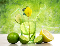 Lime and lemon cocktail over green background Stock Image