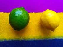 Lime and lemon on colorful background Stock Photography