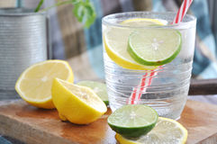 Lime and lemon in fresh drink Stock Image