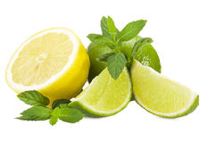 Lime,lemon and fresh leaves of mint Royalty Free Stock Image