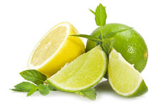 Lime,lemon and fresh leaves of mint Stock Photos