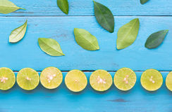 a Lime lemon are half cut and arrange to column on blue wooden b Royalty Free Stock Photos