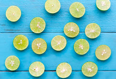 a Lime lemon are half cut on blue wooden background Stock Photos